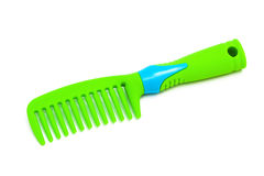 Green plastic hairbrush Royalty Free Stock Photo