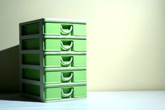 Green plastic home organizer drawer Stock Images