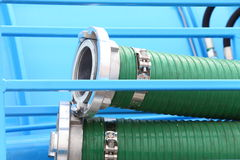 Green plastic hose tube outdoor Stock Photo
