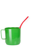 Green plastic mug with toothbrush Stock Photography