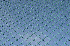 Green plastic net sport pattern blue sky Royalty Free Stock Photos