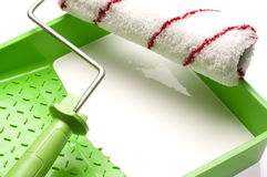 Green plastic paint tray and roller Royalty Free Stock Photos