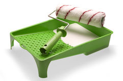 Green plastic paint tray and roller Stock Images