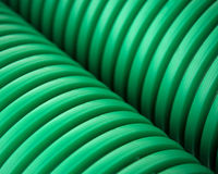 Green plastic pipes Stock Images