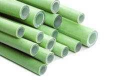 Green plastic pipes. Pile of green plastic pipes on white Royalty Free Stock Photo