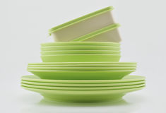Green plastic plates, bowls and boxes isolated on white backgrou Royalty Free Stock Photography