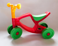 Green plastic with red tricycle on white background Stock Images