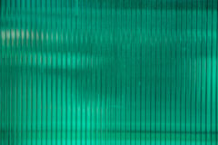 Green plastic sheet of polycarbonate material. Green plastic sheet of polycarbonate on the building Royalty Free Stock Photo