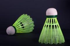Green plastic shuttlecocks. Two green plastic shuttlecocks on black background Stock Image