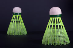 Green plastic shuttlecocks. Two green plastic shuttlecocks on black background Royalty Free Stock Photos
