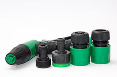 Green plastic sprayer for garden with accessories Stock Images