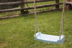 Green Plastic Swing. Children Green Plastic Swing in the playground Royalty Free Stock Photo