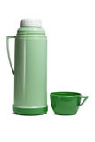 Green plastic thermos flask. With cup on white background Royalty Free Stock Photos