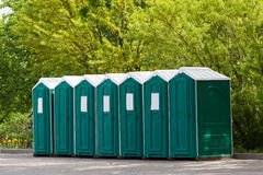 Green plastic toilet booths. In park Royalty Free Stock Image