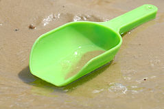 Green Plastic Toy Beach Scoop Stock Image