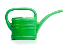 Green plastic toy watering can Stock Photo