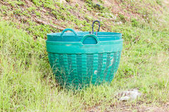 Green plastic trash basket. Stock Photos