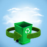 Green plastic trash recycling container ecology concept, with landscape background. Stock Images