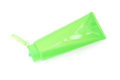 Green plastic tube with opened  flip top lid Royalty Free Stock Photography