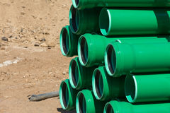 Green plastic tubes on a construction site Stock Image