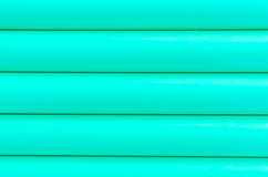 Green plastic tubing pattern texture background Stock Photography