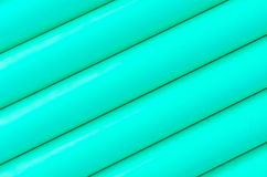 Green plastic tubing pattern texture background Royalty Free Stock Images