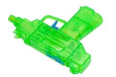 Green plastic water pistol Stock Photo