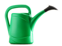 Green plastic watering can on white Royalty Free Stock Photography
