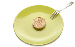 Green plate with cereal dietary pastry Royalty Free Stock Photo