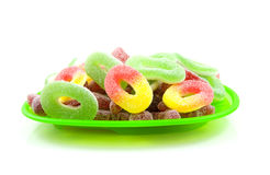 Green plate with colorful sugar candy sweets Stock Photo