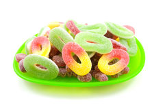 Green plate with colorful sugar candy sweets Stock Image
