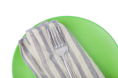 Green plate with cutlery Royalty Free Stock Images