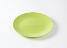 Green plate Stock Images
