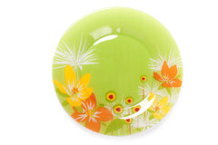 Green plate with flowers in color Royalty Free Stock Photos