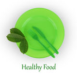 Green plate with fork and knife Royalty Free Stock Images
