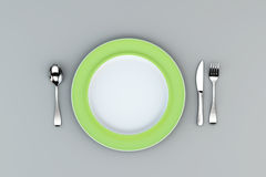 Green Plate with fork, knife and spoon Royalty Free Stock Photos