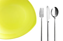 Green plate, fork, knife and spoon. On white background Stock Photos