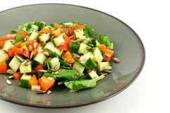 Green plate with a healthy salad isolated on white background Stock Photos