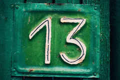 Green plate with number 13 stock photo