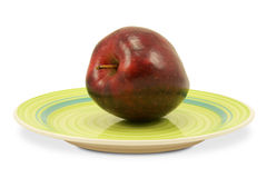 Green plate with red apple Royalty Free Stock Images
