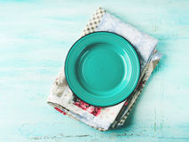 Green plate on Vintage napkin wooden textured background Royalty Free Stock Images