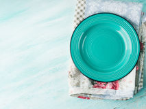Green plate on Vintage napkin wooden textured background Stock Image