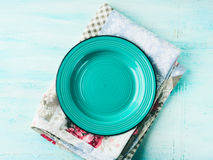 Green plate on Vintage napkin wooden textured background Stock Photography
