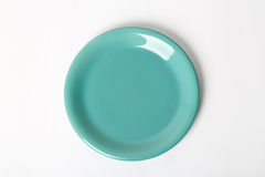 Green plate. On white background Royalty Free Stock Photo