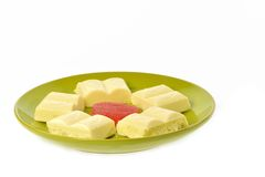 Green plate white chocolate red jujube Royalty Free Stock Photos