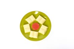 Green plate white chocolate red jujube Stock Photography