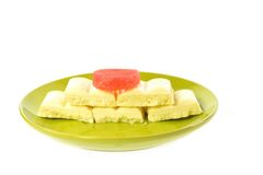 Green plate white chocolate red jujube Royalty Free Stock Images