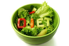 Green plate with word diet composed of slices. Of different vegetables on salad Stock Image