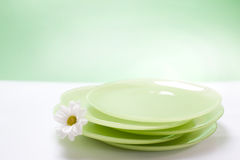 Green plates Stock Images
