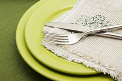 Green plates with fork and knife Royalty Free Stock Photos